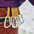 climber with quickdraws on harness