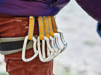 Carabiners and Quickdraws: Essential Equipment for Rock Climbing Outdoors