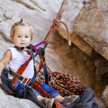 child with climbing gear